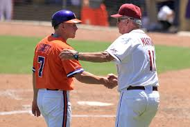 Mike Martin and Jack Leggett on baseball field shaking hands